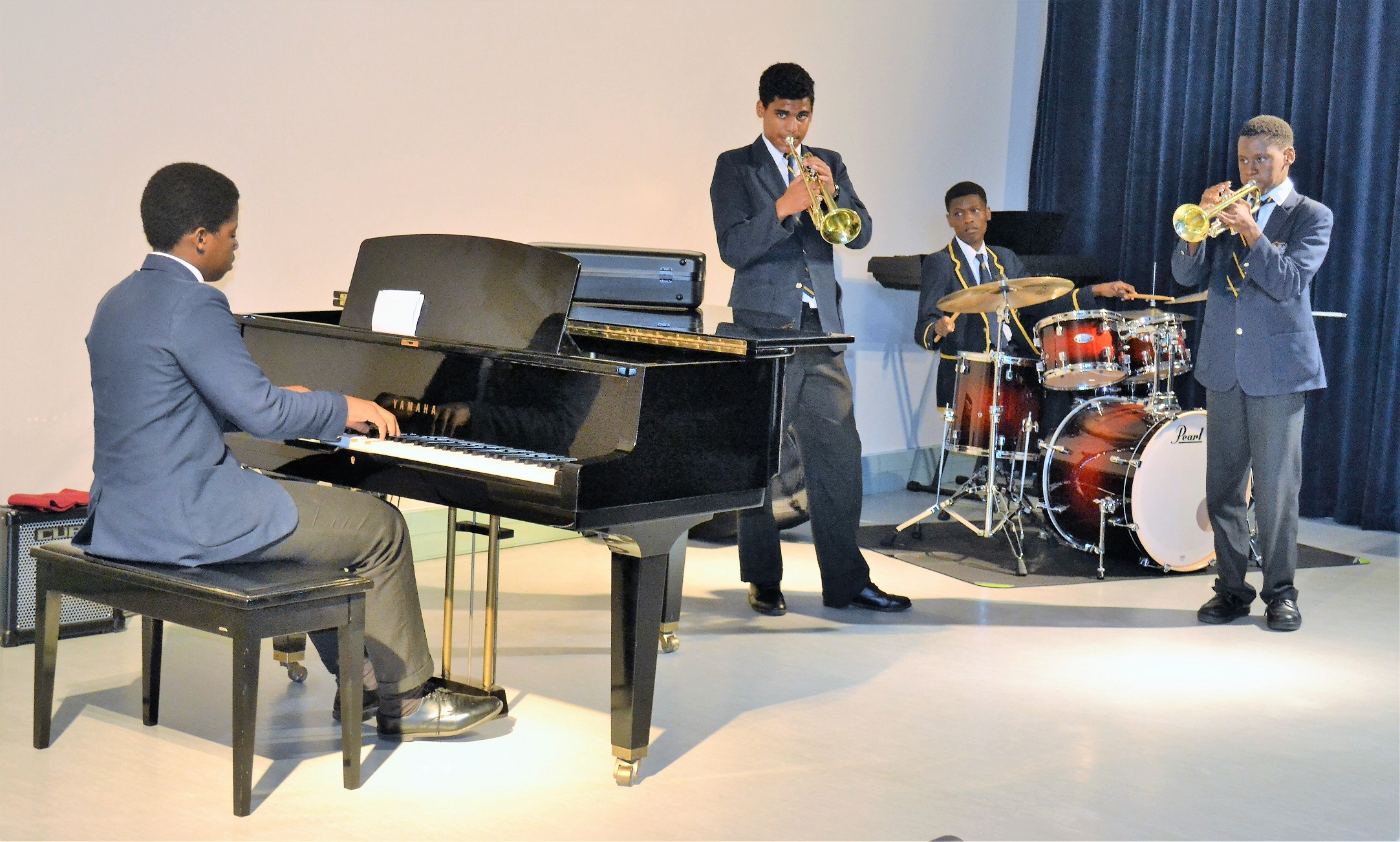 Levi Pillay, Ntokozo Nsibande and Sam Sibisi (drums) and Mhlengi Ngwenya (piano) performing at the first Lunch Time Concert in the Chris Seabrooke Music Centre