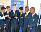 Daleen Janse van Rensburg (Solutions Adviser at Lectorsa) shows some of the DHS learners what LAB-on-line looks like while Bryan Adam (Head of Grade 8) looks on. Learners are: Israel Haines, Samuel Spooner, Asher Knox-Davies, Abderahman Assila, Michael Mudenda and Luhle Mgenge