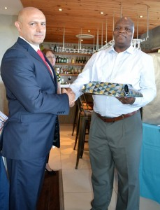 Mr Tony Pinheiro (DHS Head Master) hands over a gift to Mr Bongani Mgaga (Director of Garlicke & Bousfield).