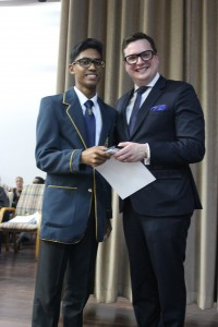 Dux, Neeven Naidoo, receives his awards from Guest Speaker, Mr Craig Kesson