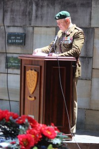 Lt Col G de Ricquebourg reads the Roll of Honour