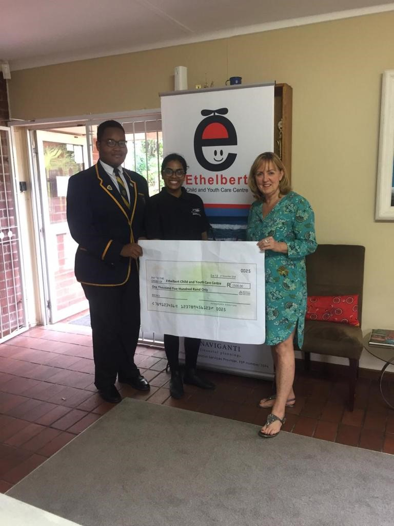 Seluleko Sabela hands the giant cheque for R1500 over to representatives of the Ethelbert Child and Youth Care Centre