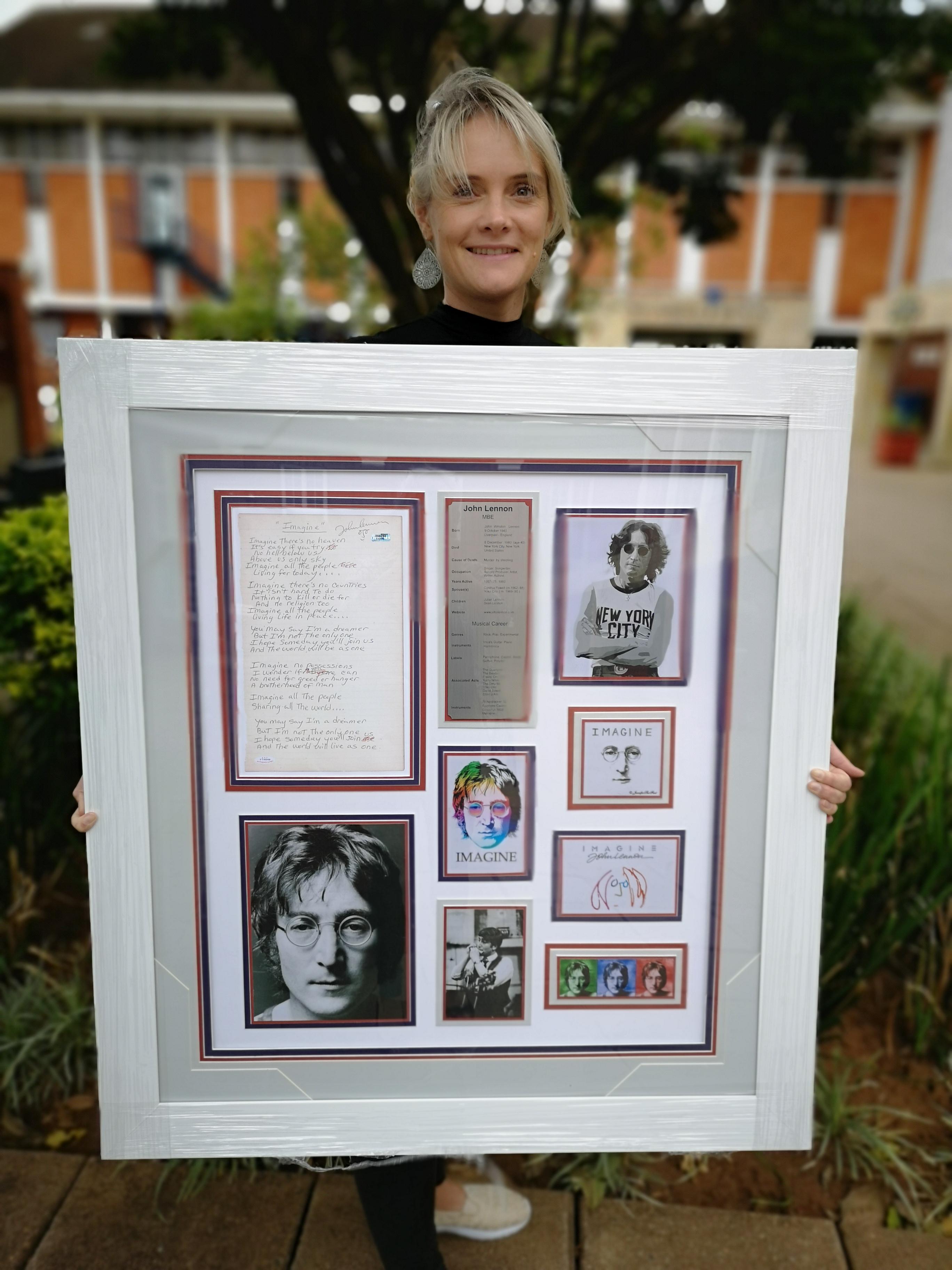 Bronwyn Bath of the DHS Foundation hold the John Lennon memorabilia