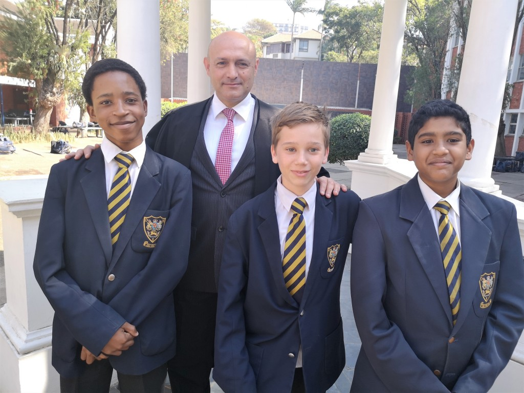 Members of the Grade 8 Debating team, Sbani Maphumulo (left), Jude Mitchell (centre) and Kian Rama with Head Master Mr A D Pinheiro