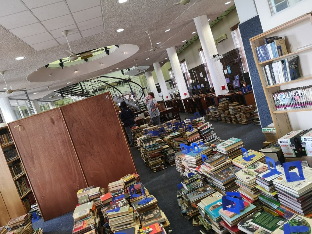 All the books being unpacked and sorted